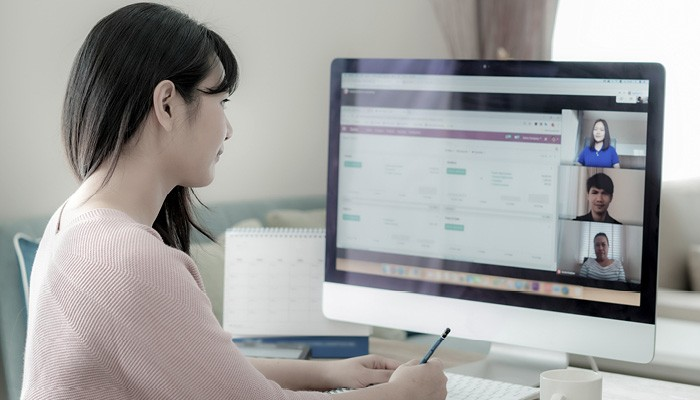 Atradius | Asian lady working from home