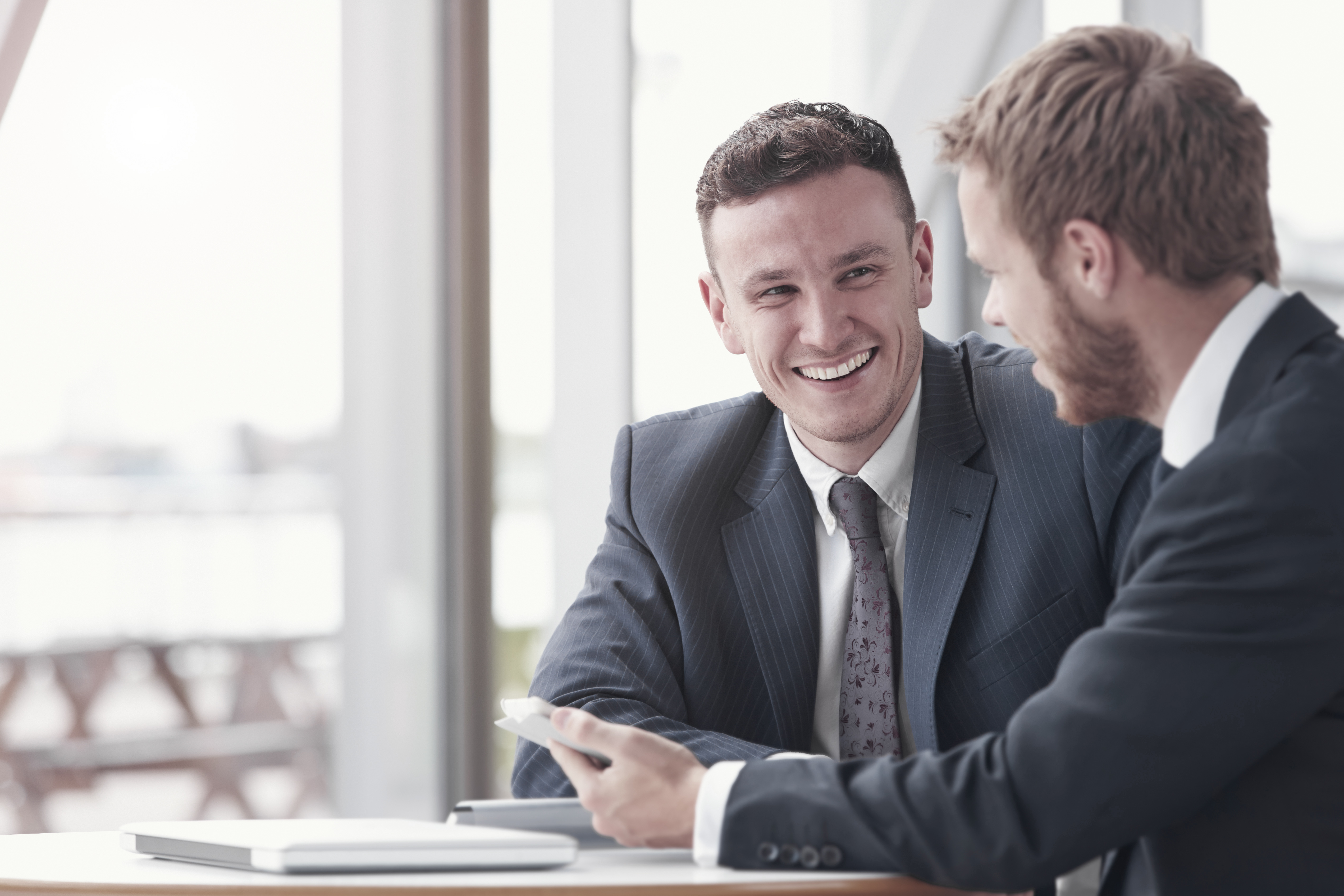 Businessmen smiling (4-3)
