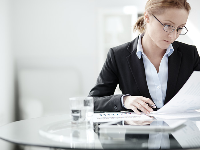 businesswoman reviewing document